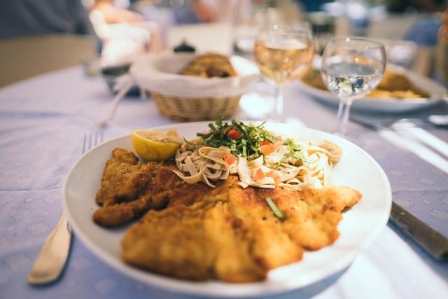 German Diners With Wiener Schnitzel in Orlando