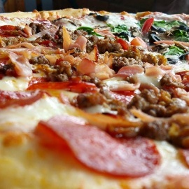 Piled High With Toppings & Cheese | Pizza In Kissimmee