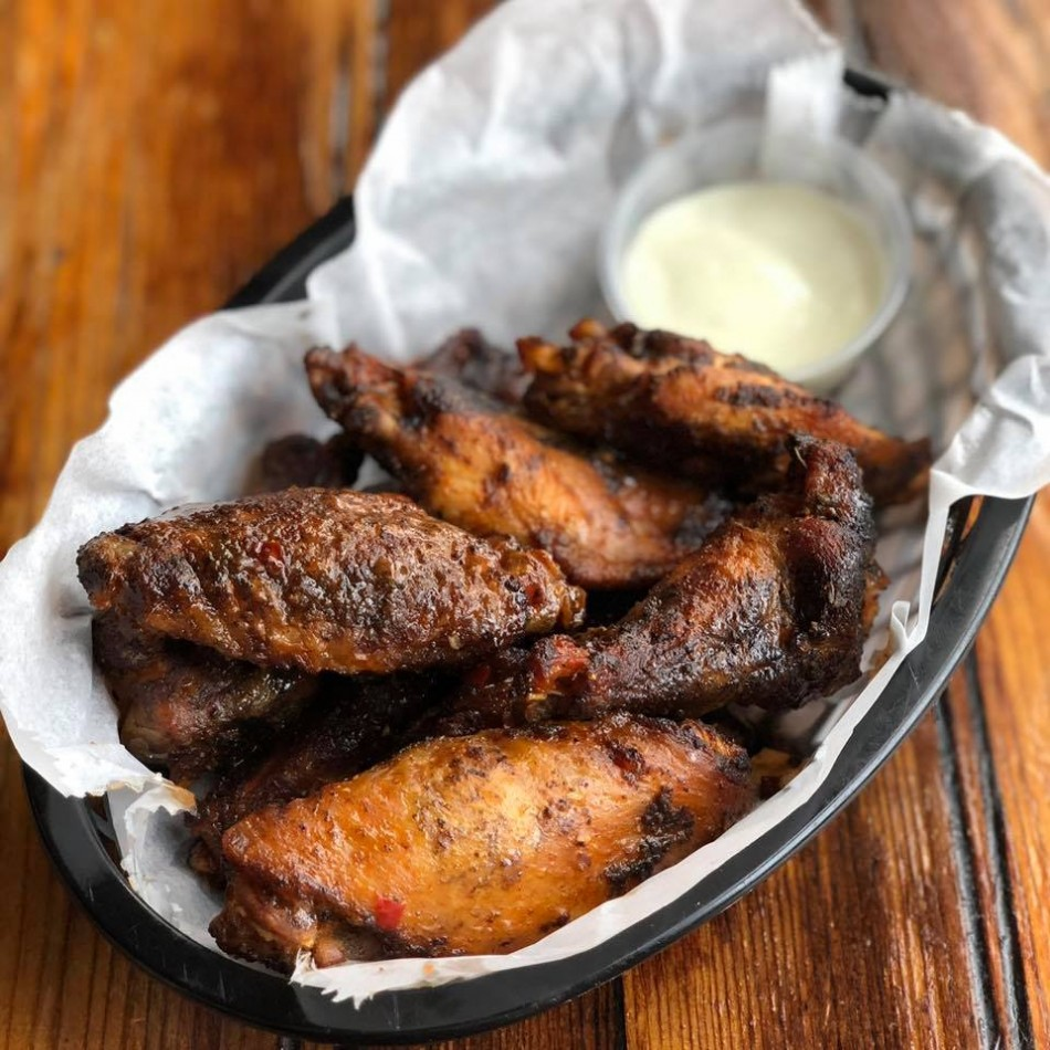 Celebrate National Chicken Wing Day at Porkchop in Hyde Park